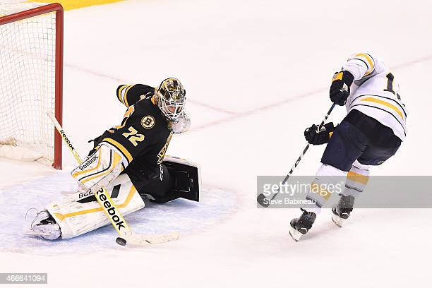 Niklas Svedberg of the Boston Bruins makes a save against Brian Gionta of the Buffalo Sabres at the TD Garden on March 17 2015 in Boston Massachusetts