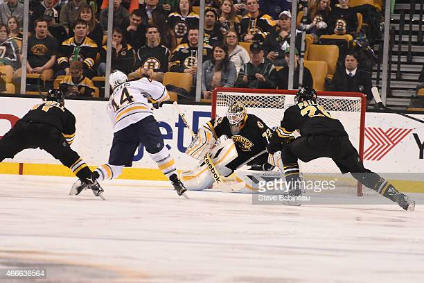 Niklas Svedberg of the Boston Bruins makes a save against Nicholas Deslauriers of the Buffalo Sabres at the TD Garden on March 17 2015 in Boston...