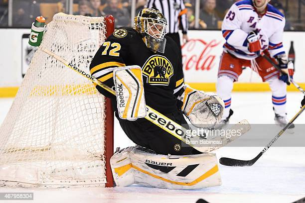 Niklas Svedberg of the Boston Bruins makes a save against the New York Rangers at the TD Garden on March 28 2015 in Boston Massachusetts