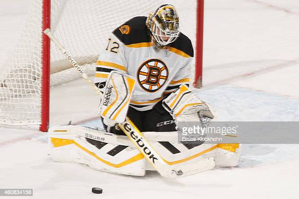 Niklas Svedberg of the Boston Bruins makes a save against the Minnesota Wild during the game on December 17 2014 at the Xcel Energy Center in St Paul...