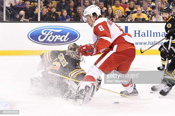 Niklas Svedberg of the Boston Bruins tries to stop the puck against Justin Abdelkader of the Detroit Red Wings at the TD Garden on March 8 2015 in...