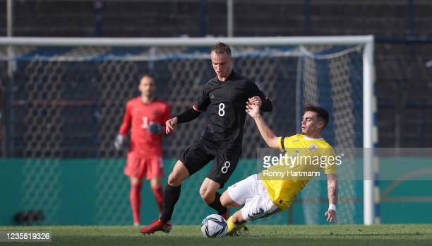 Niklas Tauer from U20 Germany and Cristi Dumitru of U20 Romania compete for the ball during the International Friendly match between Germany U20 and...
