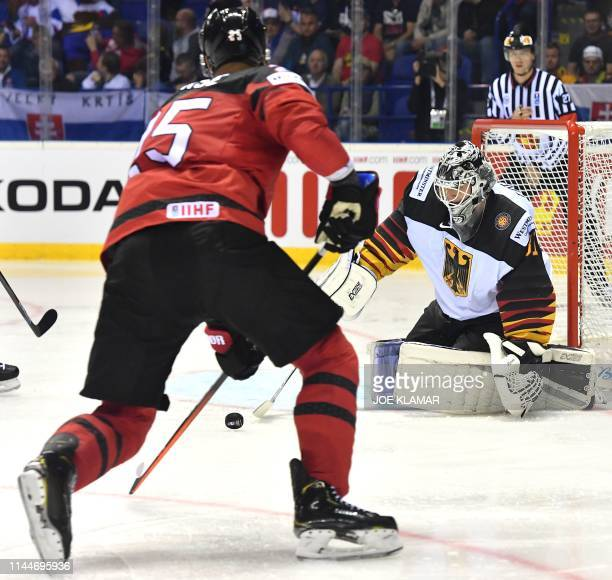 Niklas Treutle of Germany saves the puck from Canada's Darnell Nurse during the group A stage match Canada vs Germany of the 2019 IIHF Ice Hockey...