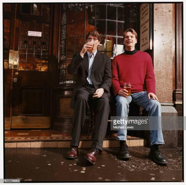 CEO Niklas Zennstrom and Vice President Janus Friis of Skype enjoy beers outside a pub in London