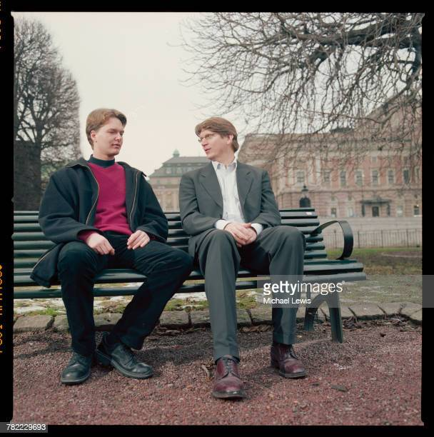 CEO Niklas Zennstrom and Vice President Janus Friis of Skype on a park bench in London