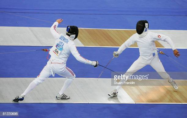 Niklaus Bruenisholz of Switzerland and Chad Senior of the United States duel in the men's fencing event of the modern pentathlon on August 26 2004...