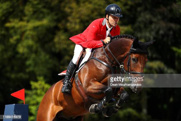 Niklaus Rutschi of Switzerland riding Cardano CH competes during Day 3 of the Longines FEI Jumping European Championship speed competition against...