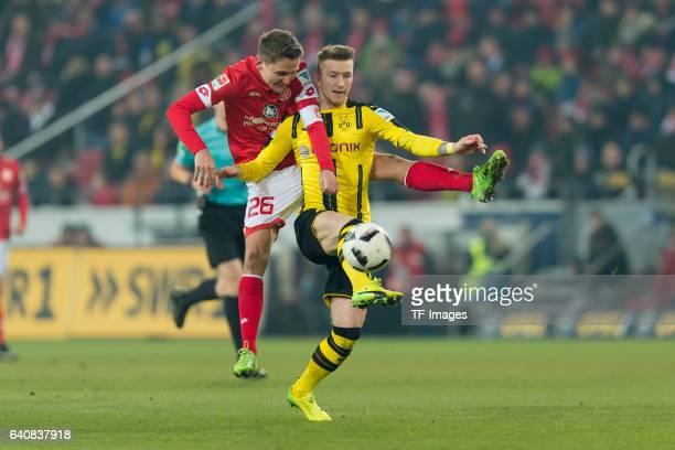 Niko Bungert of Mainz and Marco Reus of Dortmund battle for the ball during the Bundesliga match between 1 FSV Mainz 05 and Borussia Dortmund at the...