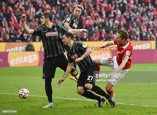 Niko Bungert of Mainz and Nicolas Hoefler of Freiburg compete for the ball during the Bundesliga match between FSV Mainz 05 and SC Freiburg at Coface...