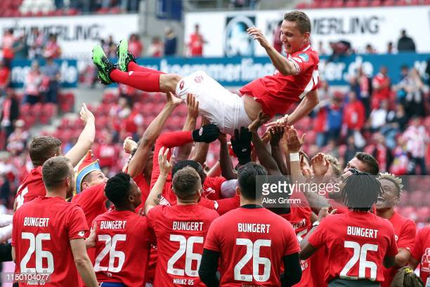 Niko Bungert of Mainz celebrates with his team mates after the Bundesliga match between 1. FSV Mainz 05 and TSG 1899 Hoffenheim at Opel Arena on May...
