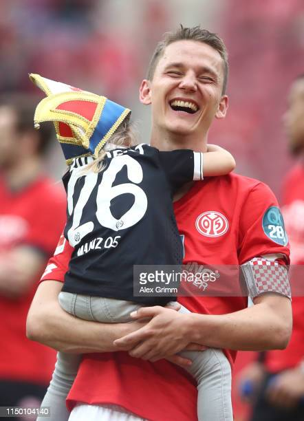 Niko Bungert of Mainz reacts during a farewell ceremony after the Bundesliga match between 1. FSV Mainz 05 and TSG 1899 Hoffenheim at Opel Arena on...