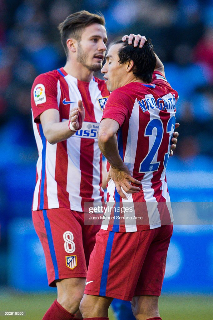 Niko Gaitan and Saul Niguiz of Atletico Madrid reacts during the La Liga match between Deportivo Alaves and Atletico Madrid at Mendizorroza stadium on January 28, 2017 in Vitoria-Gasteiz, Spain.