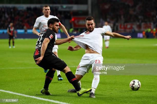 Niko Giebelmann of Fortuna Duesseldorf is challenged by Kevin Volland of Bayer 04 Leverkusen during the Bundesliga match between Bayer 04 Leverkusen...