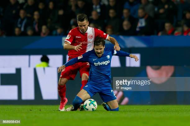Niko Giesselmann and Stefano Celozzi of Bochum battle for the ball during the Second Bundesliga match between VfL Bochum 1848 and Fortuna Duesseldorf...