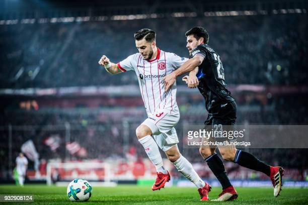 Niko Giesselmann of Duesseldorf and Florian Dick of Bielefeld in action during the Second Bundesliga match between Fortuna Duesseldorf and DSC...
