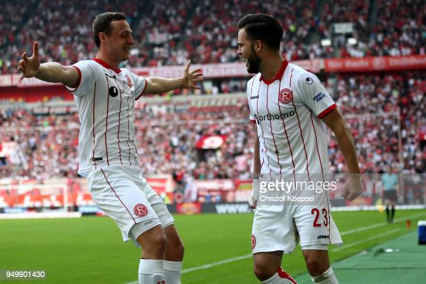 Niko Giesselmann of Duesseldorf celebrates the second goal with Julian Schauerte of Duesseldorf during the Second Bundesliga match between Fortuna...