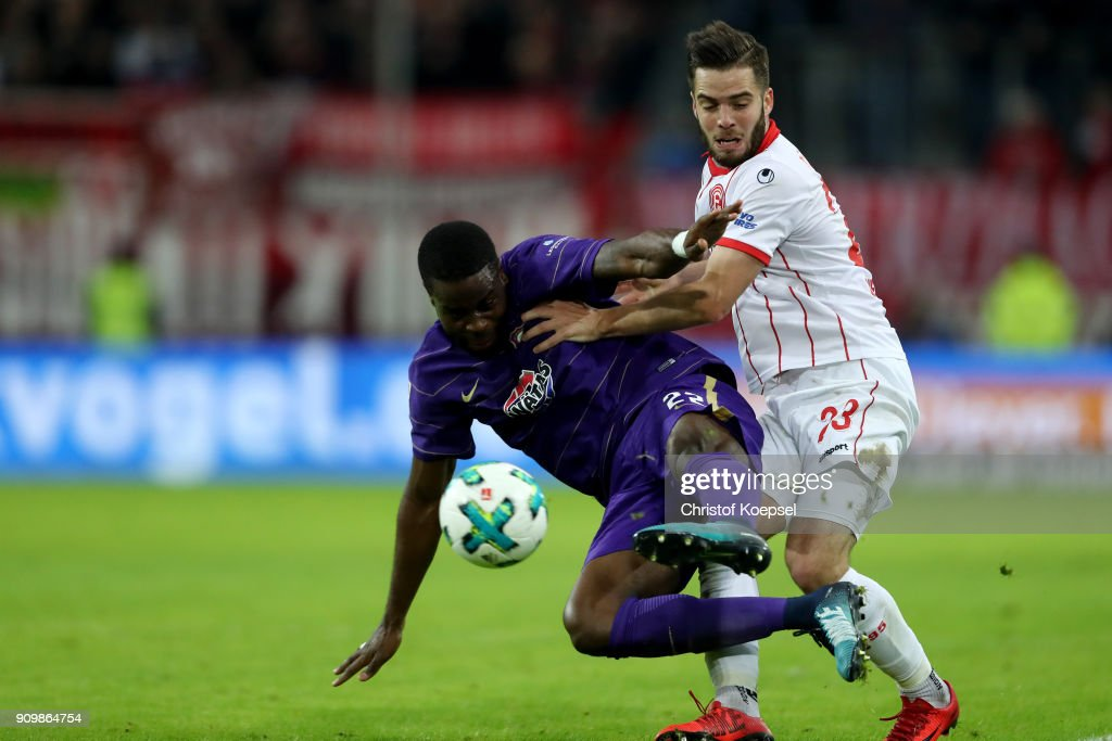 Niko Giesselmann of Duesseldorf (R) challenges Ridge Munsy of Erzgebirge Aue (L) during the Second Bundesliga match between Fortuna Duesseldorf and FC Erzgebirge Aue at Esprit-Arena on January 24, 2018 in Duesseldorf, Germany. The match between Duesseldorf and Aue ended 2-1.