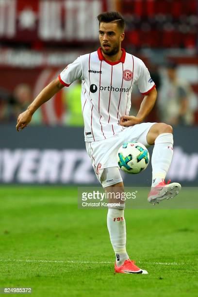 Niko Giesselmann of Duesseldorf runs with the ball during the Second Bundesliga match between Fortuna Duesseldorf and Eintracht Braunschweig at...