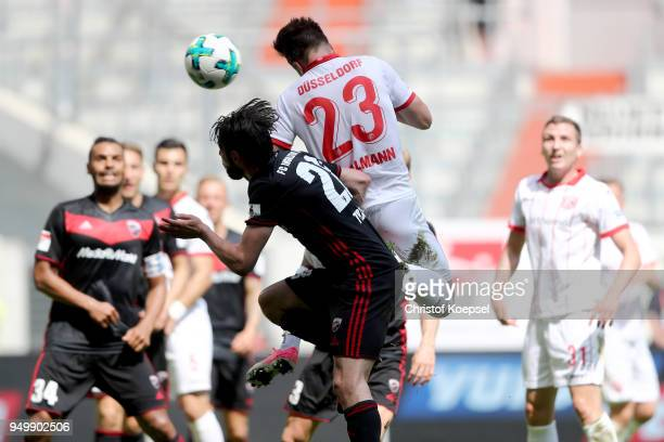 Niko Giesselmann of Duesseldorf scores the second goal against Christian Traesch of Ingolstadt during the Second Bundesliga match between Fortuna...