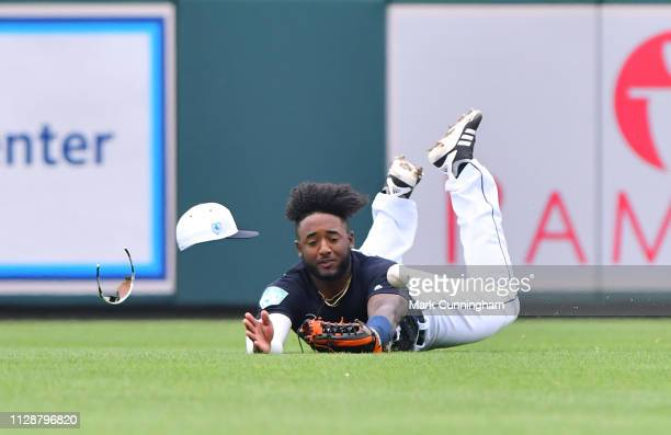 Niko Goodrum of the Detroit Tigers attempts to make a diving catch on a line drive during the Spring Training game against the Toronto Blue Jays at...