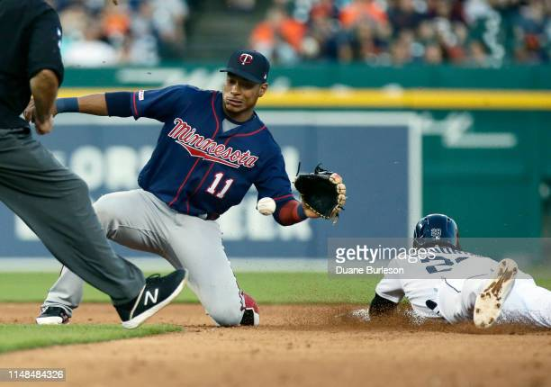 Niko Goodrum of the Detroit Tigers beats the pickoff throw to shortstop Jorge Polanco of the Minnesota Twins to steal second base during the fifth...