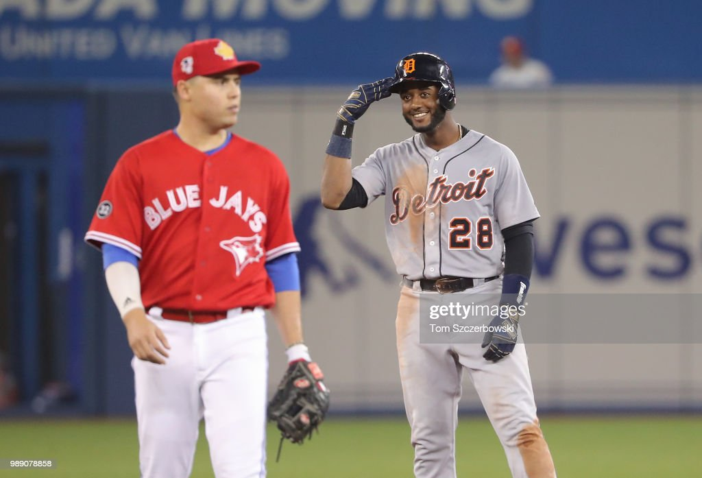 Niko Goodrum #28 of the Detroit Tigers celebrates from second base after hitting a double in the sixth inning during MLB game action against the Toronto Blue Jays at Rogers Centre on July 1, 2018 in Toronto, Canada.