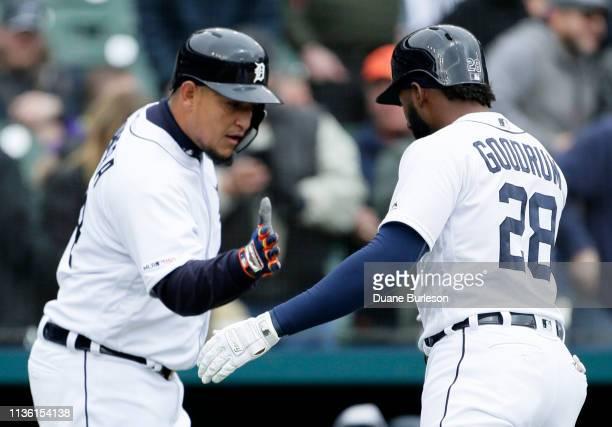 Niko Goodrum of the Detroit Tigers celebrates with Miguel Cabrera of the Detroit Tigers after hitting a tworun home run that scores Cabrera against...