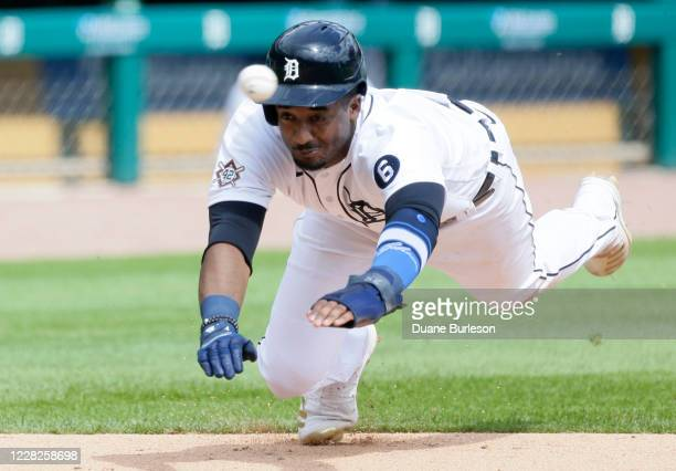 Niko Goodrum of the Detroit Tigers dives into home plate during the fifth inning of game one of a doubleheader against the Minnesota Twins at...