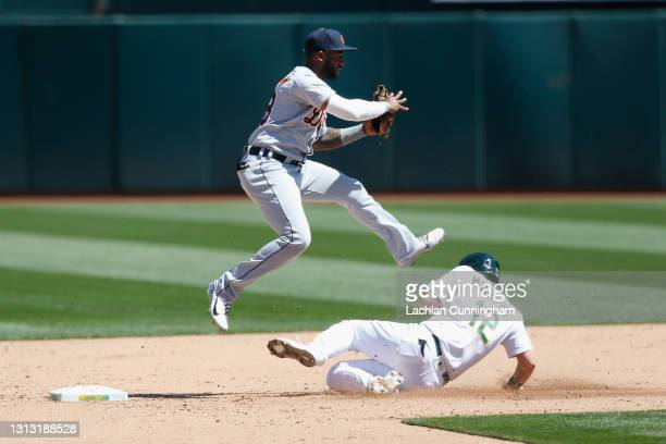 Niko Goodrum of the Detroit Tigers gets the out at second base of Sean Murphy of the Oakland Athletics and turns a double play in the bottom of the...