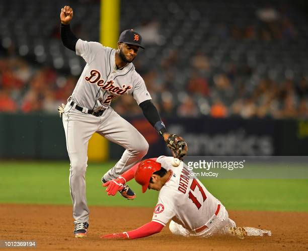 Niko Goodrum of the Detroit Tigers has the ball knocked loose by Shohei Ohtani of the Los Angeles Angels of Anaheim who stole second base in the...