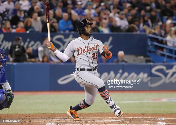 Niko Goodrum of the Detroit Tigers hits a double in the eighth inning during MLB game action against the Toronto Blue Jays at Rogers Centre on March...
