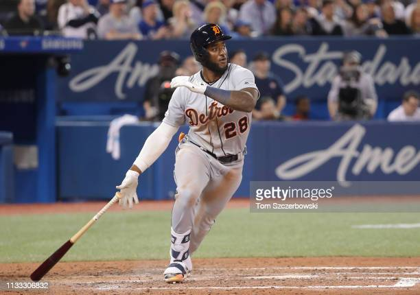 Niko Goodrum of the Detroit Tigers hits a double in the tenth inning on Opening Day during MLB game action against the Toronto Blue Jays at Rogers...