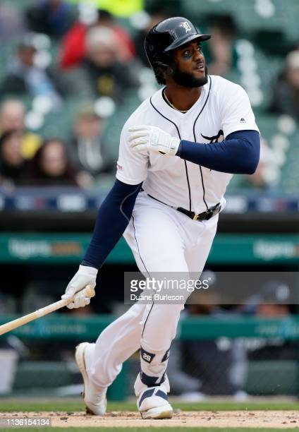 Niko Goodrum of the Detroit Tigers hits a tworun home run that scores Miguel Cabrera against the Cleveland Indians during the first inning at...