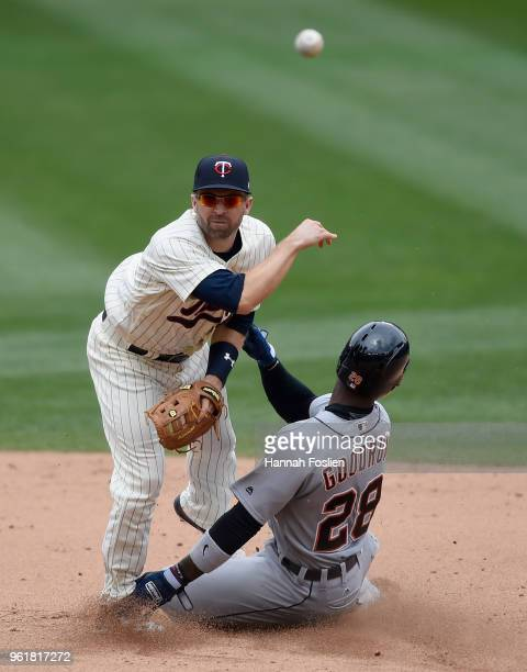 Niko Goodrum of the Detroit Tigers is out at second base as Brian Dozier of the Minnesota Twins turns a double play during the sixth inning of the...