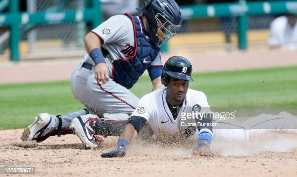 Niko Goodrum of the Detroit Tigers is tagged by catcher Alex Avila of the Minnesota Twins at home plate during the fifth inning of game one of a...