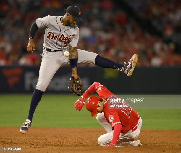 Niko Goodrum of the Detroit Tigers isn't able to come up with the ball allowing Shohei Ohtani of the Los Angeles Angels of Anaheim to steal second...