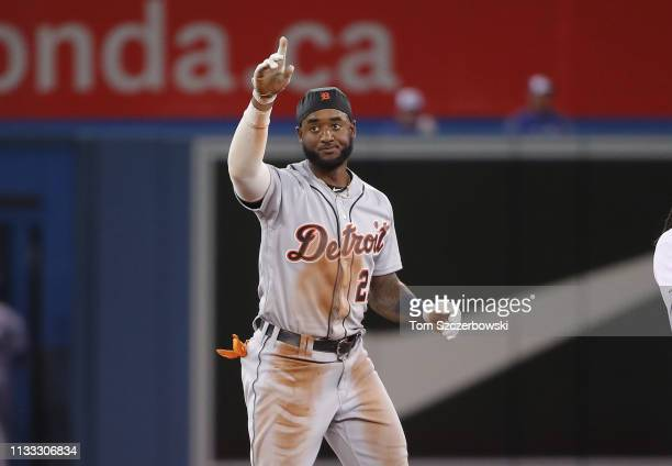 Niko Goodrum of the Detroit Tigers reacts after hitting a double in the tenth inning on Opening Day during MLB game action against the Toronto Blue...