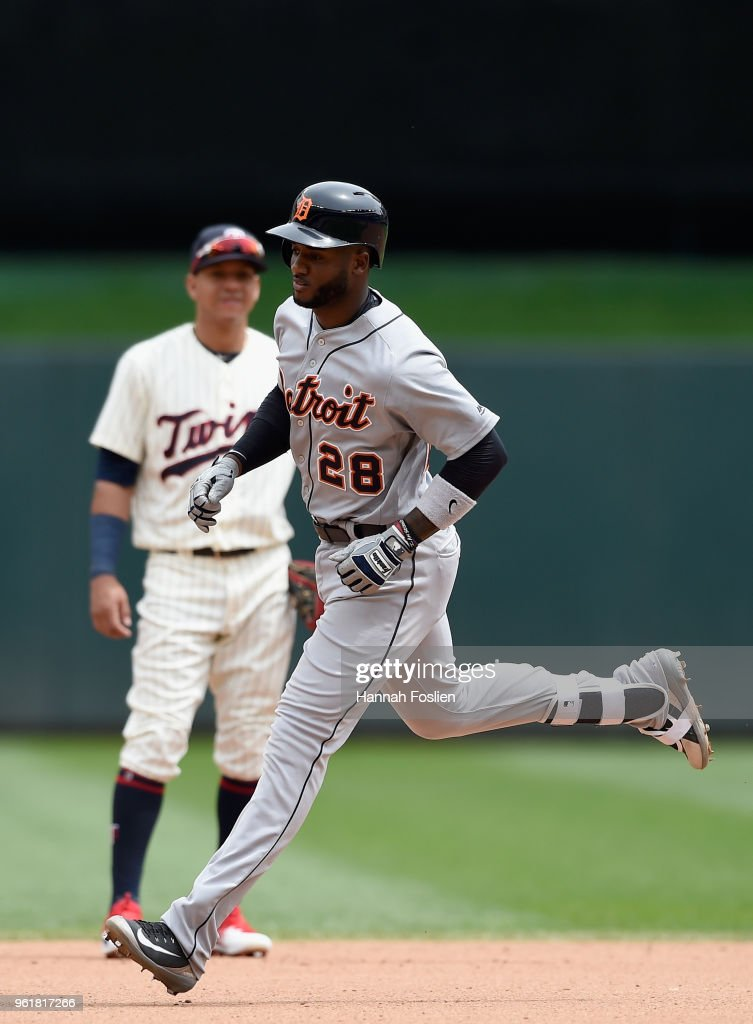 Niko Goodrum #28 of the Detroit Tigers rounds the bases after hitting a two-run home run as Ehire Adrianza #16 of the Minnesota Twins looks on during the fourth inning of the game on May 23, 2018 at Target Field in Minneapolis, Minnesota. The Tigers defeated the Twins 4-1.