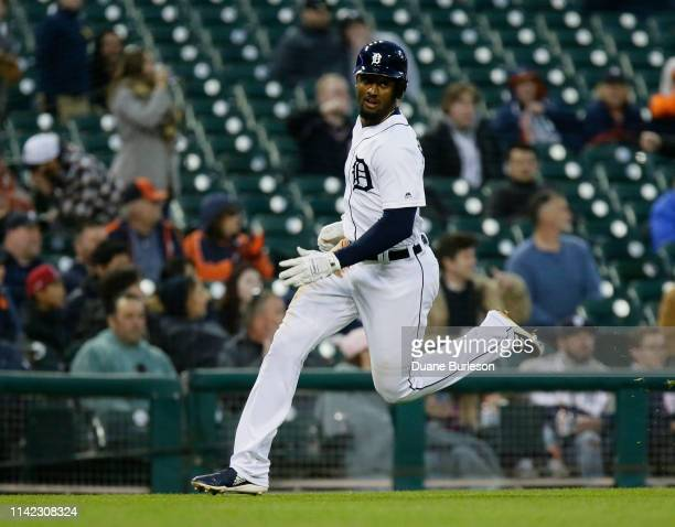 Niko Goodrum of the Detroit Tigers rounds third base to score against the Los Angeles Angels of Anaheim on a double by Ronny Rodriguez of the Detroit...