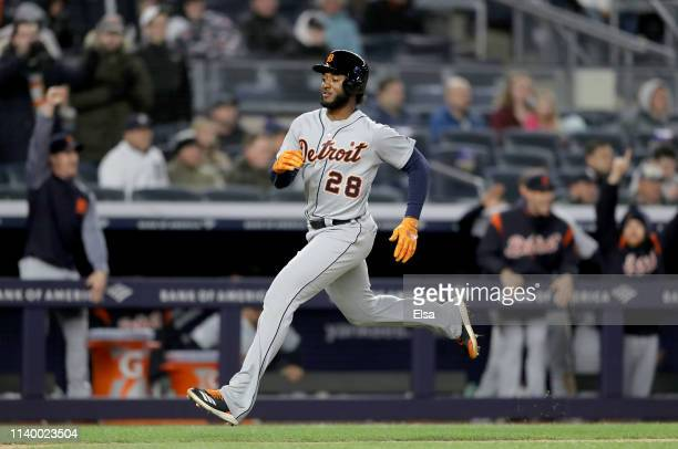 Niko Goodrum of the Detroit Tigers scores the game winning run on a double from teammate Dustin Peterson in the ninth inning against the New York...