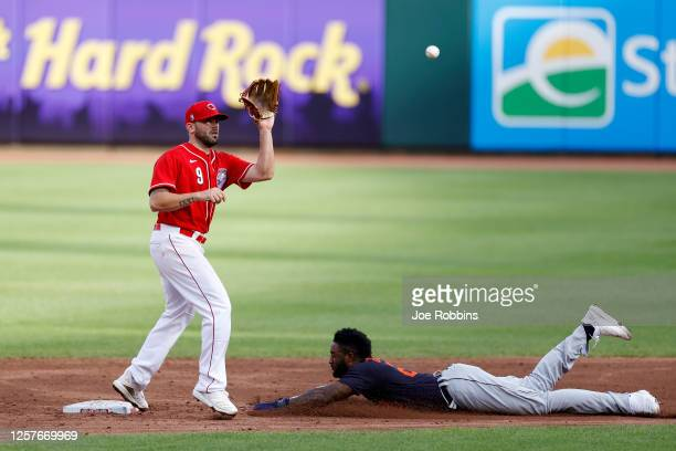 Niko Goodrum of the Detroit Tigers steals second base ahead of the throw to Mike Moustakas of the Cincinnati Reds in the third inning of an...