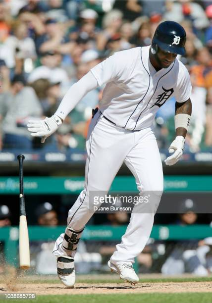 Niko Goodrum of the Detroit Tigers throws down his bat as he flies out against the Kansas City Royals during the sixth inning at Comerica Park on...
