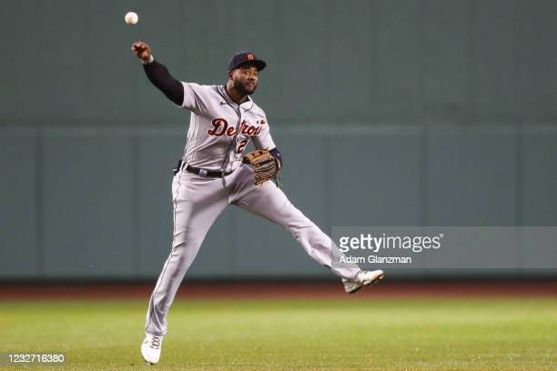 Niko Goodrum of the Detroit Tigers throws to first base in the fourth inning of a game against the Boston Red Sox at Fenway Park on May 5, 2021 in...