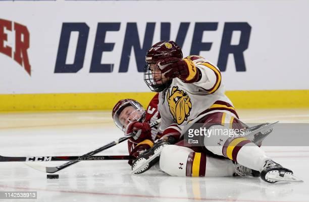 Niko Hildenbrand of the Massachusetts Minutemen and Matt Anderson of the Minnesota-Duluth Bulldogs collide during the 2019 NCAA Frozen Four the...