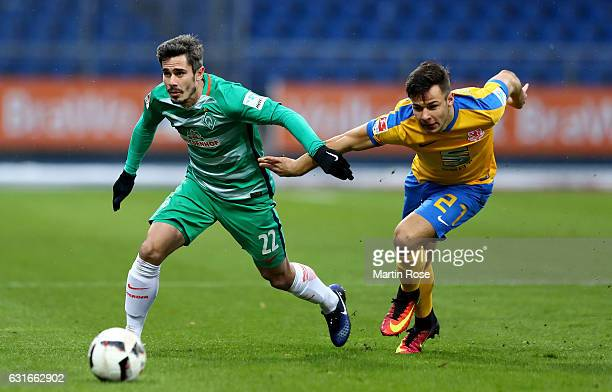 Niko Kijewski of Braunschweig and Fin Bartels of Bremen battle for the ball during the friendly match between Eintracht Braunschweig and Werder...