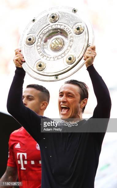 Niko Kovac head coach of Bayern Munich lifts the trophy following the Bundesliga match between FC Bayern Muenchen and Eintracht Frankfurt at Allianz...