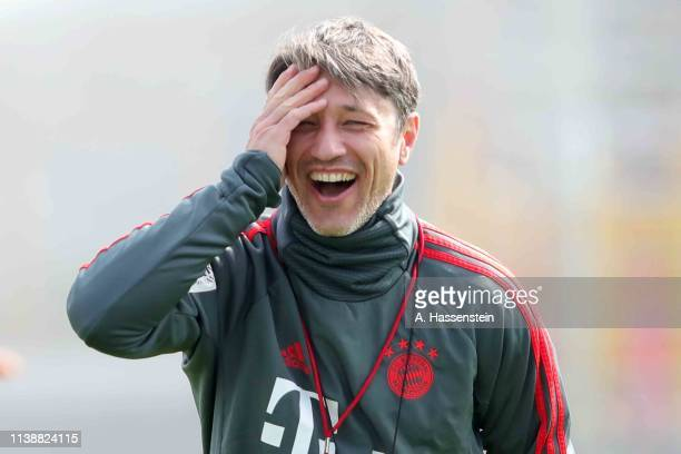 Niko Kovac, head coach of FC Bayern laughs during a FC Bayern Muenchen training session at Saebener Strasse training ground on March 28, 2019 in...