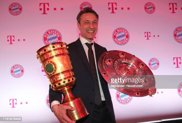 Niko Kovac head coach of FC Bayern Muenchen poses with the DFB Cup and Bundesliga Championship trophies during the FC Bayern Muenchen DFB Cup final's...