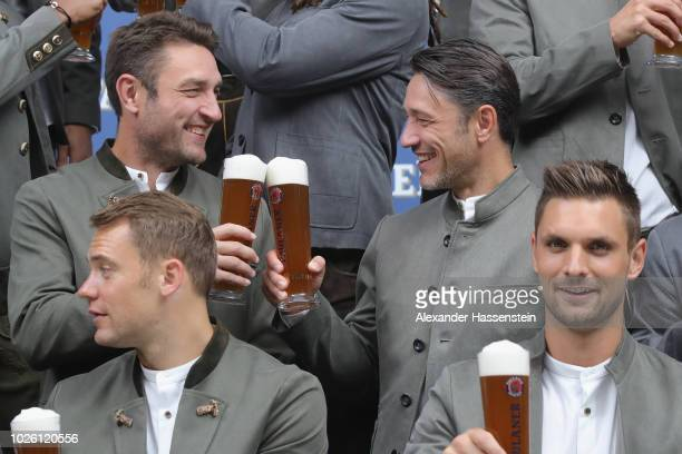 Niko Kovac head coach of FC Bayern Muenchen smiles with his brother Robert Kovac during the FC Bayern Muenchen and Paulaner Photo Session at FGV...