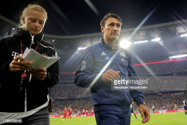 Niko Kovac, head coach of Muenchen looks on next to Kathleen Krueger, team manager of Muenchen during the Audi cup 2019 semi final match between FC...